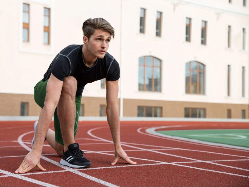 Male athlete ready to run on running track